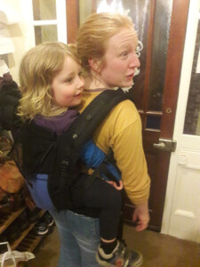 Mum is back carrying her large preschooler