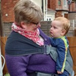 scootababy buckle carrier sling baby toddler front hip back ring sling hire buy rent library try before you buy Scootababy grey Granny gets handsfree cuddles so can focus on chatting with her grandson.