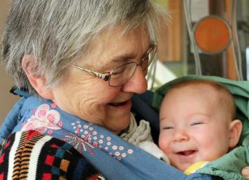 Grandma keeps her new grandshild very happy indeed.