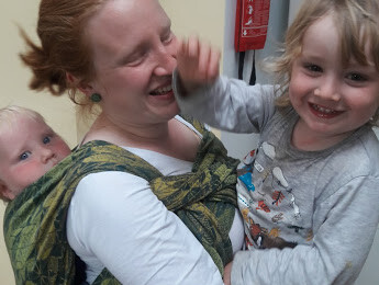 baby carrier sling hire sling library sling rental tandem carrying sling wrap in arms woven kaleidoscope gorse glasto cotton firespiral toddler brorthers tandem big brotther baby toddler little happy family fun kitchen play cuddle