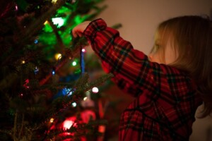 festive family traditions decorating tree